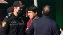 Polis malları yanan sahibkarın oğlunu saxladı, insanlar etiraz etdi - VİDEO